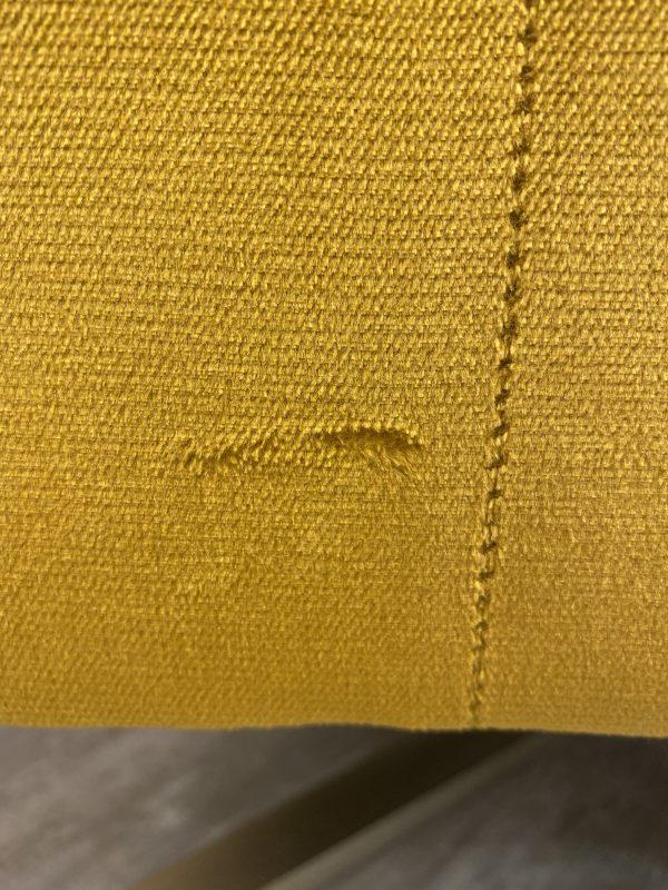 fabric damage