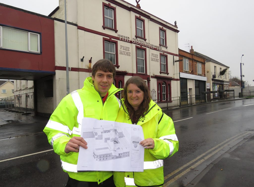 Matt and Emily Scott outside The George Hotels with plans for Sopha.