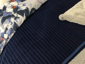 blue throw on a bed